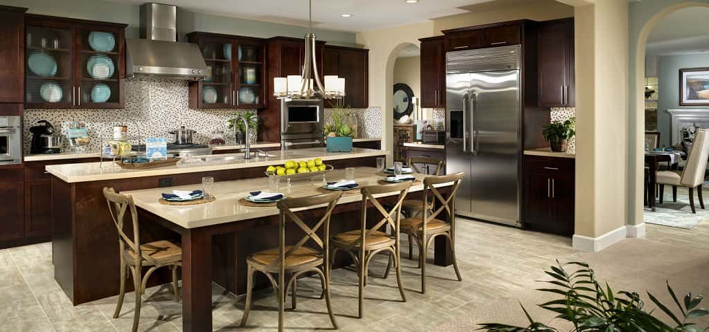 When asked about popular design features, Liz Ramirez, San Diego Marketing Director at Pardee Homes, was quick to mention the entertainer's kitchen, featuring a bi-level island with a built-in table for informal eating, socializing or doing homework.<br /> <br /> The kitchen seamlessly connects with the spacious family room, placing the cook in the center of the action. Natural light streams through the surrounding windows and French doors, which open onto a view of your covered patio and backyard.<br /> <br /> PHOTO COURTESY OF<br /> Pardee Homes