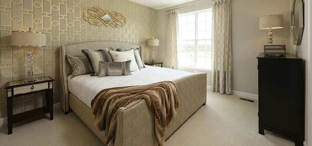 Gold embellishments are a bold way to make the third level master bedroom the luxurious retreat you've always dreamt about.<br /> <br /> McCormack adds that for the three-level plan, buyers can choose a two-foot rear extension, adding more living areas to an already spacious bedroom. In addition, buyers can add a tray ceiling to create a more voluminous effect.<br /> <br /> PHOTO COURTESY OF<br /> Timberlake Homes