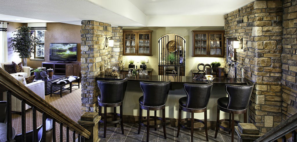"Stylish stone and an arched iron gate add a natural, yet classical, feel to this wet bar in the <a href=""https://www.newhomesource.com/resourcecenter/slideshows/home-of-the-week-residence-7545-plan-by-century-communities"" target=""_blank"" title=""Learn More About the Residence 7545 Plan"">Residence 7545 Plan</a>. Located in Lone Tree, Colo., <a href=""https://www.newhomesource.com/builder/century-communities/about/668"" title=""Century Communities"">Century Communities</a> helps this home become your own private paradise. While you may only get vacation but once or twice a year, every weekend can feel like you're hanging out in downtown Venice.<br /> <br /> PHOTO COURTESY OF<br /> Century Communites"