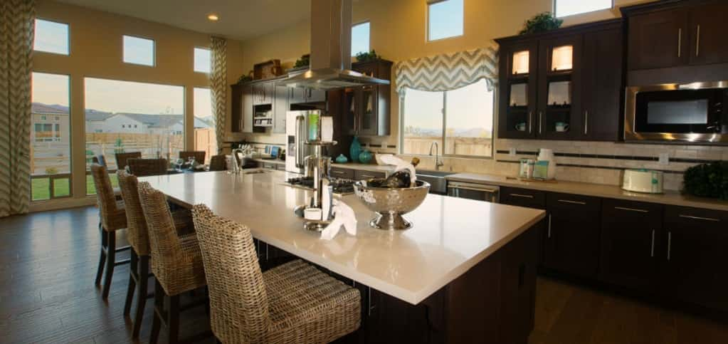 """The kitchen space is very cool,"" says Taylor Cohee, director of Sales and Marketing for Ryder Homes. ""If someone is really involved with cooking, they're still able to interact with other family members who are in the great room or breakfast nook.""<br /> <br /> In addition to a great layout, the kitchen includes a large kitchen island with burners. A tech center comes standard to help families keep electronics stored in a safe place (and it's great for keeping said electronics charged).<br /> <br /> PHOTO COURTESY OF<br /> Ryder Homes"
