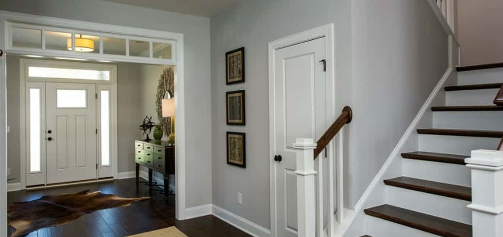 "Today's busy families are always on the go. But, when they're not, it's nice to have a place to greet guests when entertaining, like in this foyer of the Cabot plan by Savvy Homes at Stone Briar in Clayton, N.C.<br /> <br /> ""With so many of us receiving more packages than ever, as well as having all of our children's friends coming in and out, a lot of people want their home to be inviting, but still want privacy,"" says Jeannette Bodnar, marketing director for Savvy Homes. ""It really adds to the appeal of the floor plan.""<br /> <br /> PHOTO COURTESY OF<br /> Savvy Homes"