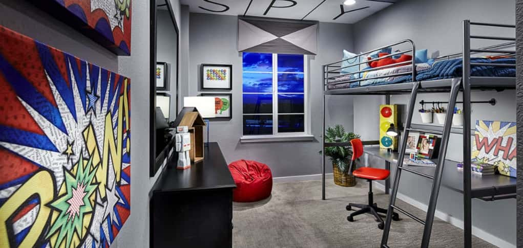 Pow! Wham! That's the effect the design in this kids' room has — bold, unique and fun. Here's just an example of how you can create a fun hideaway for the superhero or comic book fan in your family, using just one paint color and a few colorful pieces of artwork.<br /> <br /> A loft/bunk combination provides study space for students without overcrowding the room. But don't think the secondary rooms can't fit your guests or other family members — the spacious secondary bedrooms can easily be personalized to fit your needs.<br /> <br /> PHOTO COURTESY OF<br /> Shea Homes