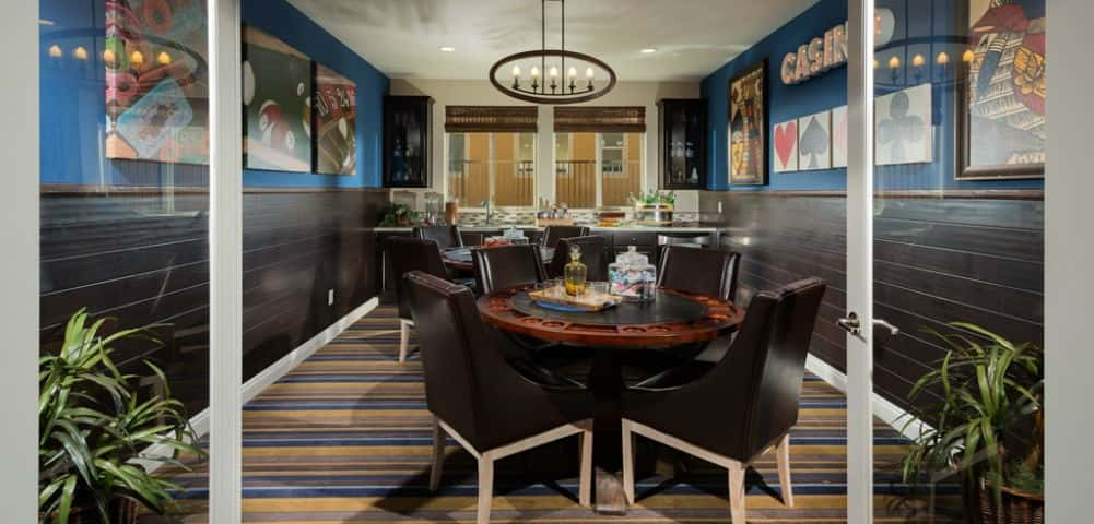 "No Las Vegas home is complete without a casino room. And no casino room is complete without a wet bar! The <a href=""https://www.newhomesource.com/resourcecenter/slideshows/home-of-the-week-silverton-plan-model-plan-2a-by-pardee-homes"" target=""_blank"" title=""Learn More About the Silverton Plan"">Silverton Plan</a> by <a href=""https://www.newhomesource.com/builder/pardee-homes/about/59"" title=""Learn More About Pardee Homes"">Pardee Homes</a> accomplishes both with this colorful and entertaining space. Who needs all the hustle and bustle of downtown Las Vegas when you could just invite the gang over for poker night?<br /> <br /> PHOTO COURTESY OF<br /> Pardee Homes"