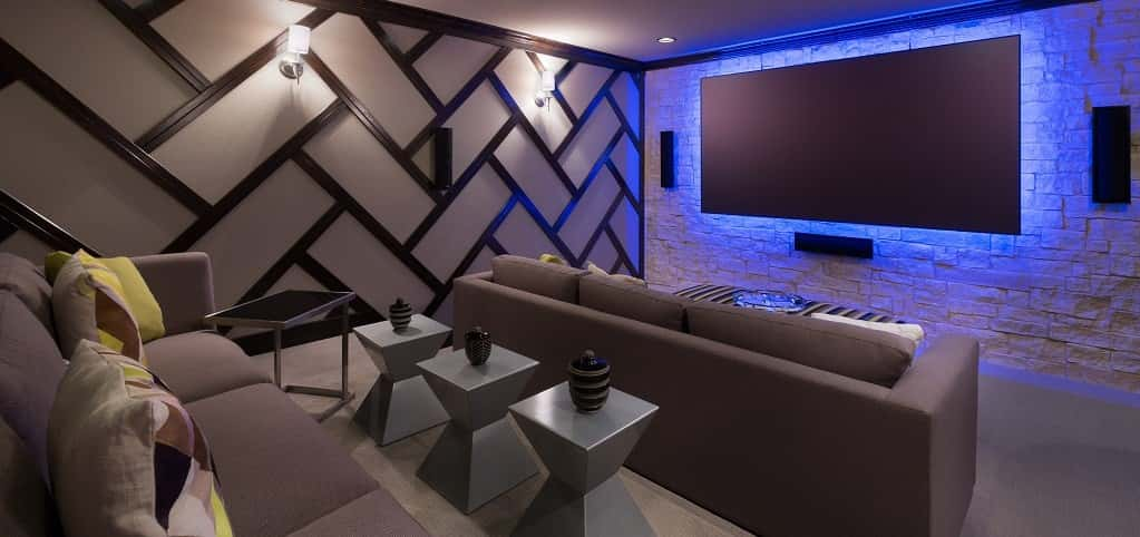 "Who wouldn't fall in love with this modern and cavernous media room? <a href=""https://www.newhomesource.com/builder/standard-pacific-homes/about/40"" target=""_blank"" title=""Standard Pacific Homes"">Standard Pacific Homes</a> does a great job blending contrasting design styles to create this sleek yet natural media room that glows. This space could make watching any movie fun, and probably make it 100 times better.<br /> <br /> PHOTO COURTESY OF <br /> Standard Pacific Homes"