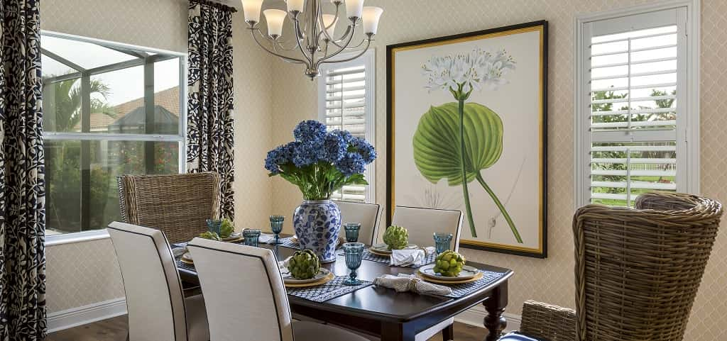 "Tasteful patterned wallpaper and light wood floors are casual influences in the home's dining room. Larger than a breakfast nook, yet smaller than a traditional formal dining room, this dining spot is large enough for family gatherings, yet intimate enough for small meals or casual dining.<br /> <br /> ""It can accommodate small and large meals,"" says Bowman. ""This is just another way that the home is adaptable to the homeowner's lifestyle.""<br /> <br /> PHOTO COURTESY OF<br /> Neal Communities"
