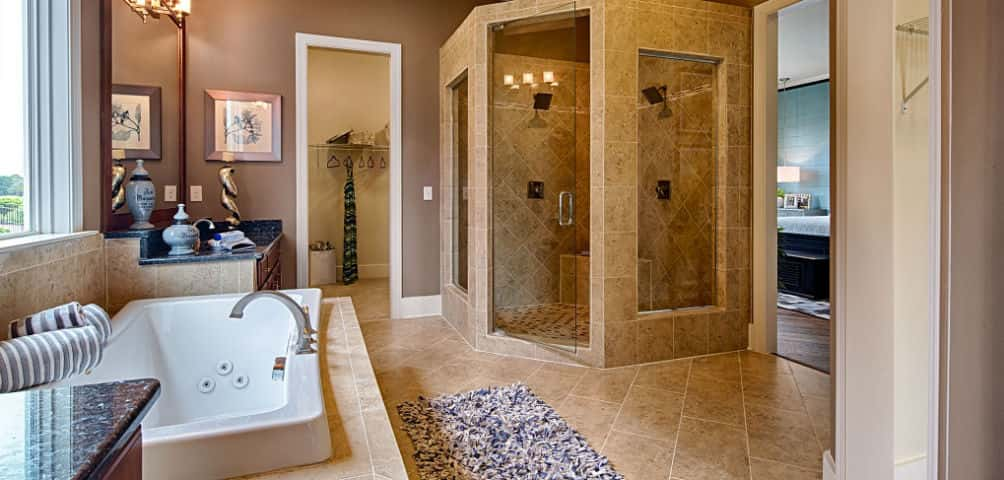 """The shower in this particular plan is to die for,"" Becker says. ""It carries on the spa-feel from the owner's retreat.""<br /> <br /> In addition to the walk-in shower, there's a soaking tub and dual vanities. The walk-in closet provides ample space for clothes, shoes and accessories.<br /> <br /> PHOTO COURTESY OF<br /> Schumacher Homes"
