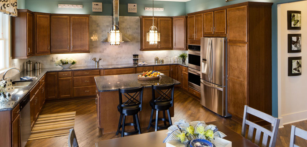 Many folks complain that there's never enough storage space in the kitchen. In the Stoneridge A, that won't be a problem.<br /> <br /> The kitchen's open floor plan includes a center island for casual dining, double pantries and enough counter space for cooking and baking, storing items and for drinks and hors d'oeuvres during gatherings.<br /> <br /> PHOTO COURTESY OF<br /> Schumacher Homes