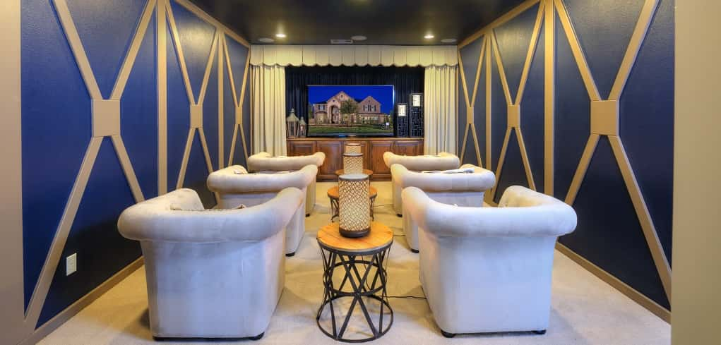 The home's master suite is not the only place to unwind — how about taking in a movie in the home's media room, here styled as a personal movie theater. Blue walls are accented with white trim. White carpet and six plush, white seats provide theater seating for family and friends.<br /> <br /> PHOTO COURTESY OF<br /> Taylor Morrison