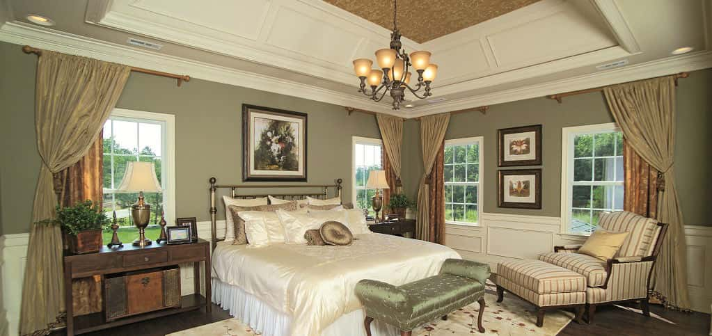 "Immediately upon entering the master bedroom, your eye is drawn upward to the gorgeous optional cathedral ceiling. Combined with plenty of natural light and a private sitting area, the master suite is the perfect retreat from the hustle and bustle of everyday life.<br /> <br /> ""The sitting area (master den) is the most popular feature of this bedroom,"" says Thierrin, noting that it transforms the space from a simple place to sleep to a refuge to hang out and relax.<br /> <br /> PHOTO COURTESY OF<br /> Toll Brothers"