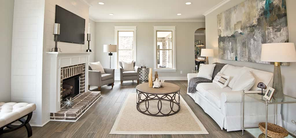 <p>The living room features great wall space for superb placement of furniture and windows, letting in just the right amount of natural light. And with 9-foot ceilings, there's plenty of room for ultimate comfort.<br /> <br /> Additional features like a shiplap fireplace accent and wood-like tile add a country charm to the space. Like what you see here? The Tower Homes design center is already waiting to discuss options with you.</p> <p >PHOTO COURTESY OF<br /> Tower Homes</p>