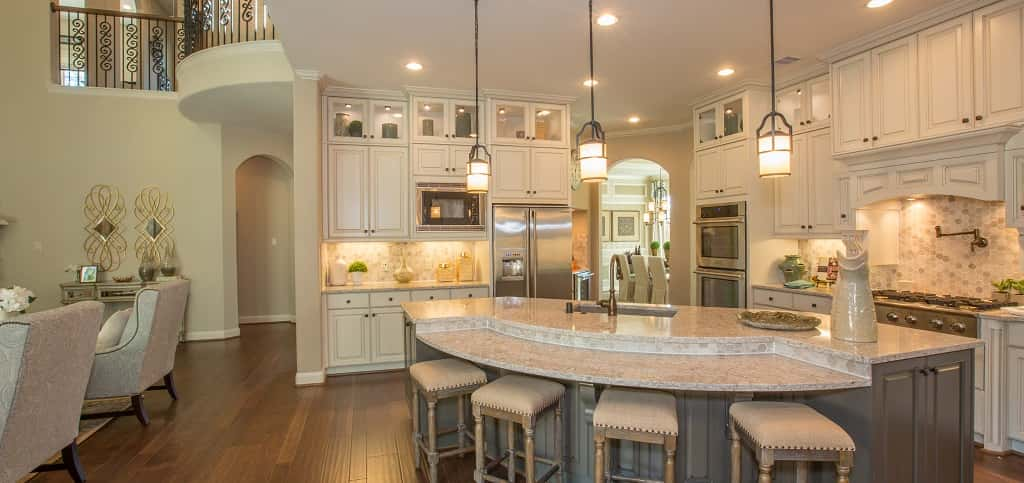 "Designed for entertaining, this kitchen is not just a functional space; it's a showstopper. An all-white kitchen is airy and inviting, like the kitchen of the Stanton 6071 plan by <a href=""https://www.newhomesource.com/builder/village-builders/about/87"" target=""_blank"" title=""Village Builders"">Village Builders</a>. This kitchen comes equipped with everything a homeowner could want in a dream kitchen: a spacious, fan-shaped granite kitchen island, pot filler, stained maple cabinetry, a butler's pantry and an Electrolux appliance package, to boot.<br /> <br /> PHOTO COURTESY OF<br /> Village Builders<br /> <br /> <a href=""https://www.newhomesource.com/communityresults/market-279/brandid-87"">Village Builders in Pinehurst, Texas</a>"