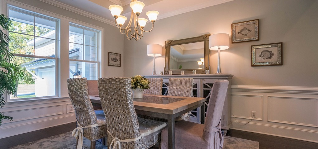 <p>This formal dining room's tray ceiling, not shown, wainscoting and simple chandelier will make every meal feel rich and unique, even on weekdays.<br /> <br /> Here, a six-seat table comfortably fits in the dining room; however, the spacious room can easily accommodate bigger parties for large gatherings.</p> <p> </p> <p>PHOTO COURTESY OF<br /> Village Park Homes</p>