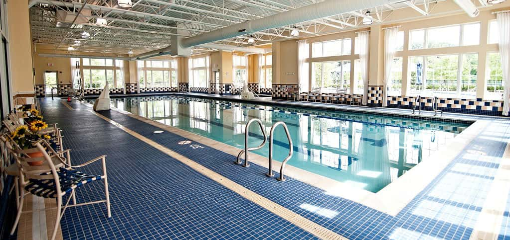 "<p>Abbeyville Plan<br /> <br /> Bridgewater community<br /> <br /> 2 bedrooms/2 baths<br /> 2-car garage<br /> 1,683 sq. ft.<br /> 1-story home<br /> <br /> Photo: An indoor swimming pool makes it easy for residents to keep fit all times of year.</p> <p >PHOTO COURTESY OF<br /> Del Webb</p> <p ><a href=""https://www.newhomesource.com/homedetail/planid-1007002"">See More Photos on NewHomeSource</a></p>"
