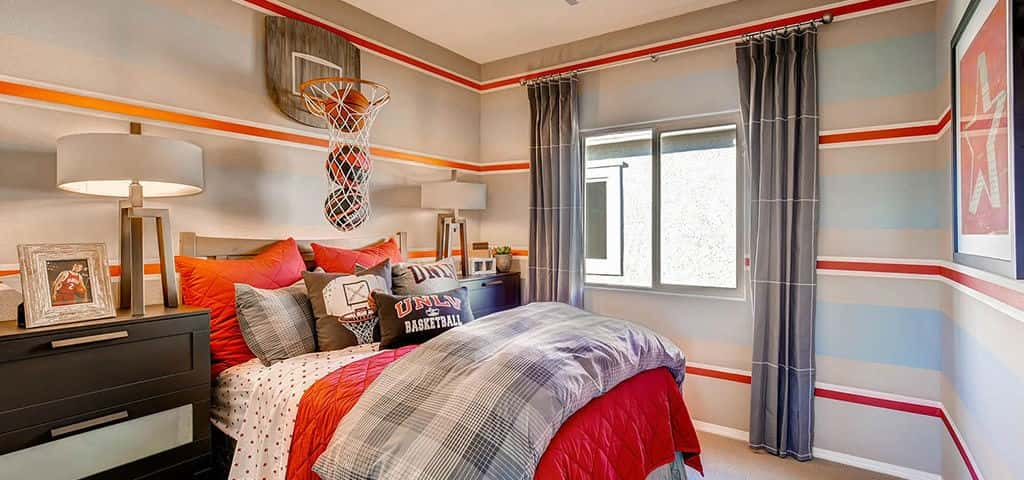 "At the Ridgehaven Community of Las Vegas, <a href=""http://www.newhomesource.com/builder/warmington-residential/about/4564"" target=""_blank"" title=""Learn More About Warmington Residential"">Warmington Residential</a> really scored with this basketball-themed bedroom. When they're not practicing on the court, your athlete in training would love to lay it up in this space.<br /> <br /> Copy the look by hanging up a hoop of your own with an elongated net, perfect for storing game balls. Bring your design in for the win with great wall décor — basketball stripes, team posters or even Fathead wall decals.<br /> <br /> PHOTO COURTESY OF<br /> Warmington Residential"
