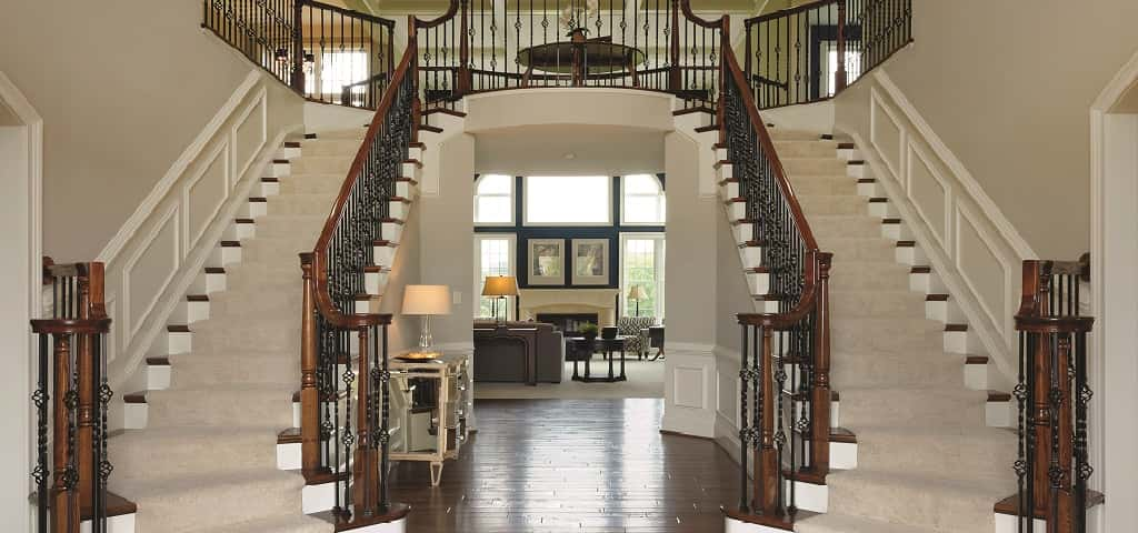 "Nothing says ""welcome"" like a stunning stairway like this one that greets guests in the <a href=""https://www.newhomesource.com/resourcecenter/slideshows/home-of-the-week-rutledge-plan-by-williamsburg-homes"" target=""_blank"" title=""See More Photos of the Rutledge Plan"">Rutledge Plan </a>by Williamsburg Homes. It's not likely you'll entertain family and friends in this space, but it's definitely one way to set the tone for the rest of your gathering.<br /> <br /> This regal double staircase is not only gorgeous, it creates a gallery wall in the center where you can display treasured artwork, photos and other favorite items.<br /> <br /> PHOTO COURTESY OF<br /> Williamsburg Homes"