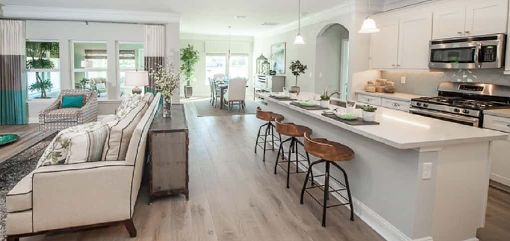 "An open floor plan combines the home's living room, kitchen and flex space, allowing residents to spend time with each other while in different areas of the home. A quartz countertop (granite is the standard option) is the highlight of the home's kitchen.<br /> <br /> ""The flow of the kitchen is paramount,"" Harris says. ""Creating a space where the cook can easily maneuver is key. ... The kitchen island is a highlight for buyers because it's not only a work station but a place to gather.""<br /> <br /> PHOTO COURTESY OF<br /> elacora"