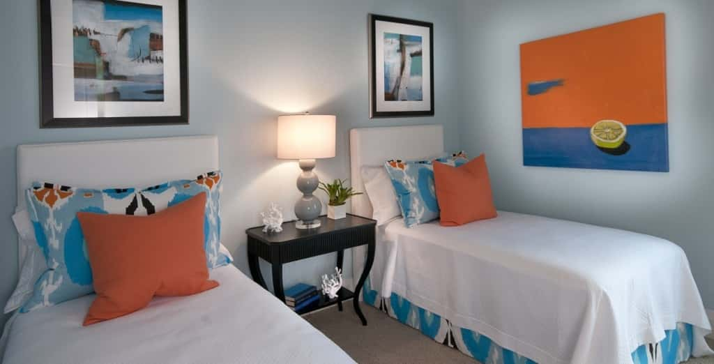 Have family coming into town? No problem. This guest room is large enough for two full beds, or any other furniture layout, for that matter.<br /> <br /> Romanza carries the cool colors accented by shots of bright colors throughout the home.<br /> <br /> PHOTO COURTESY OF<br /> London Bay Homes