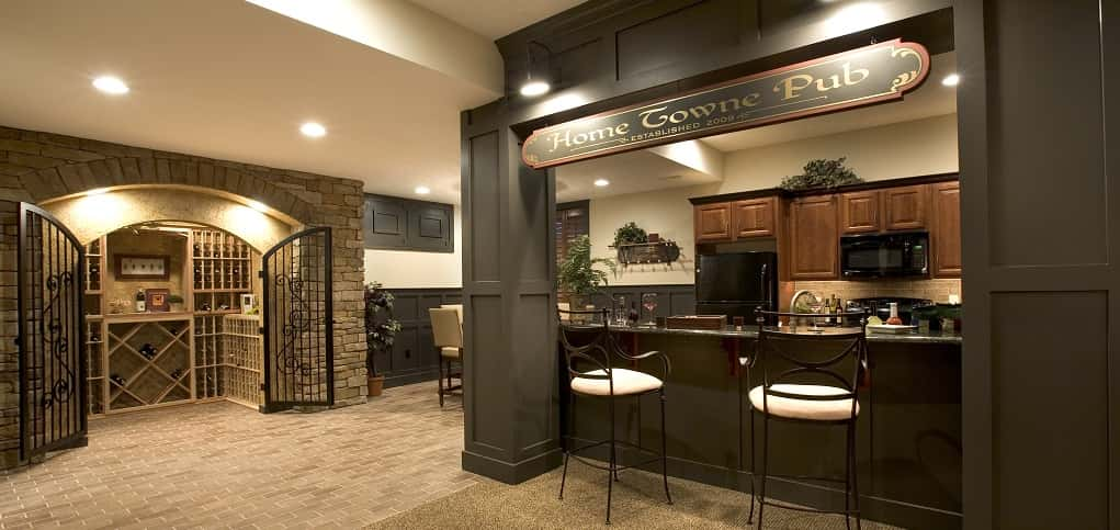 "Who needs to leave home when you've got a basement like this one in the Oakville plan from <a href=""https://www.newhomesource.com/resourcecenter/slideshows/home-of-the-week-oakville-plan-by-landmark-homes"" target=""_blank"" title=""See our Home of the Week profile on Landmark Homes"">Landmark Homes</a>? A personal pub and kitchen make it easy to entertain without having to run upstairs for supplies. An optional wine cellar is a spectacular place to show off treasured wines.<br /> <br /> The best part of this space? It's versatility — homeowners can adapt the space any way they want.<br /> <br /> PHOTO COURTESY OF<br /> Landmark Homes"