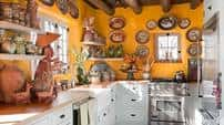 Vibrant golds, like the hue seen in this Santa Fe kitchen featured in House Beautiful, are versatile accents or main wall colors.
