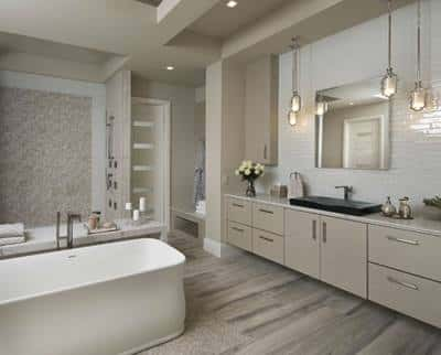 The home's master bathroom is spacious and features a freestanding tub and his-and-hers vanities and water closets.