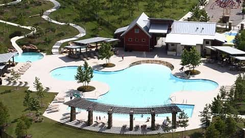 A water slide that empties into a small pool sits just west of a large, lagoon-style pool at Bonterra at Cross Creek Ranch.