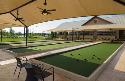 Four bocce ball courts sit outside the community amenity center at Del Webb Sweetgrass in Richmond, Texas.