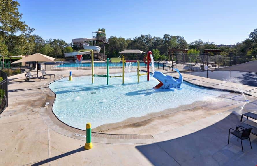 A splash pad at Alamo Ranch Harrison Grant by Pulte Homes in San Antonio features a whale sculpture, fountains and more.
