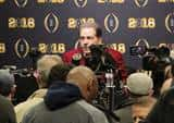 Nick Saban sits at a table during a press conference after Alabama's 2018 national championship.