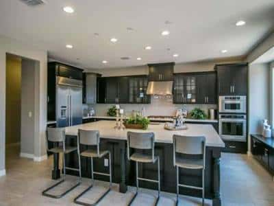A large kitchen island with granite countertop is the highlight of this spacious kitchen in the 213 Plan, a new home by CalAtlantic Homes in Phoenix.