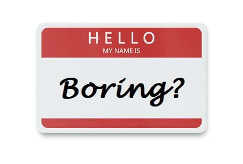 "Red and white name tag with word ""boring"""