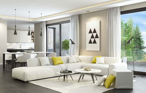 Fresh And Modern White Style Living Room Interior With Dining Table And  Kitchen In The Background