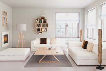 A modern living room with white furniture and natural wood table and lamp.