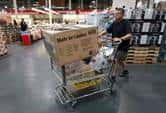 A man pushes a cart through Costco.