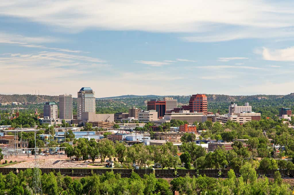 "If you prefer warmer climates, but also enjoy a cool winter, <a href=""https://www.newhomesource.com/communityresults/market-47/postalcode-80924"" target=""_blank"" title=""Search for New Homes in Colorado Springs"">Colorado Springs</a> may be the place for you. Like Denver, Colorado Springs has a sizable population, making it easy to find shopping, dining and entertainment.<br /> <br /> Unlike Denver, the cost of living in Colorado Springs is much more affordable for those who may be on a fixed income. The aerospace and high-tech industries are major players in Colorado Springs, making it a good place for those with advanced degrees to settle before retirement."