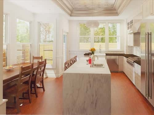 A white kitchen with a marble island and warm wood furnishings.