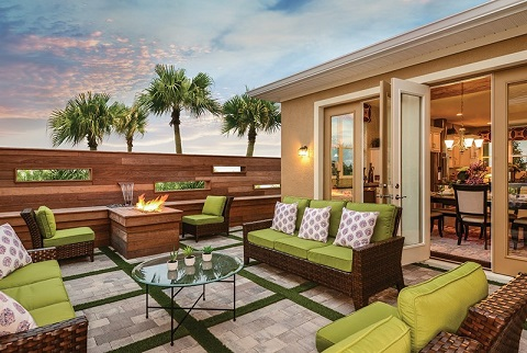 This outdoor living space uses plenty of natural materials, including wood, stone and small tufts of greenery throughout to create a festive and inviting space to entertain. The Terravista 1 Story plan by David Weekley Homes at Waterset Patio in Apollo Beach, Fla.