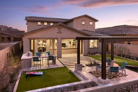 Create an outdoor living space that has character and that the whole family can enjoy, like this whimsical backyard space with permeable pavers, cornhole patch, outdoor grill and gazebo. The Winslow plan by Maracay Homes at The Cove at Center Pointe Vistoso in Oro Valley, Ariz.