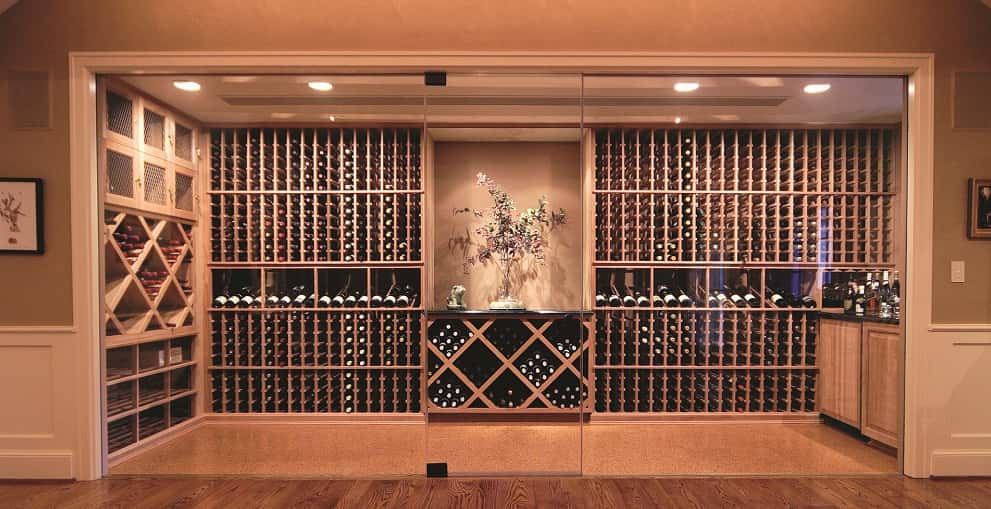 "This Pennsylvania home's elegant, glass-enclosed wine cellar from Wine Cellar Innovations exudes a certain Zen quality.<br /> <br /> The simplicity of the wine racks and the center art alcove subtly draw guests in to peruse the 2,000-plus bottle collection.<br /> <br /> The racking system is made of unstained all-heart redwood from <a href=""http://www.winecellarinnovations.com/"" target=""_blank"" title=""Wine Cellar Innovations"">Wine Cellar Innovations</a>' Platinum Series and includes wine case shelves, diamond bins and, on the top left, secured wine lockers for storing those especially valuable bottles.<br /> <br /> PHOTO COURTESY OF<br /> Wine Cellar Innovations"