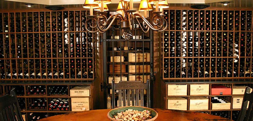 "Wine tastings take center stage in this Ohio home's wine cellar from <a href=""http://www.winecellarinnovations.com/"" target=""_blank"" title=""Wine Cellar Innovations"">Wine Cellar Innovations</a>.<br /> <br /> A full dining table provides ample room for guests to sample from the homeowner's nearly 2,500-bottle collection. A bar workstation with a sink and wine glass racks provides space for decanting and food preparation.<br /> <br /> The wine racks are all-heart redwood with a dark walnut finish giving the room a sophisticated and stately feel.<br /> <br /> PHOTO COURTESY OF<br /> Wine Cellar Innovations"