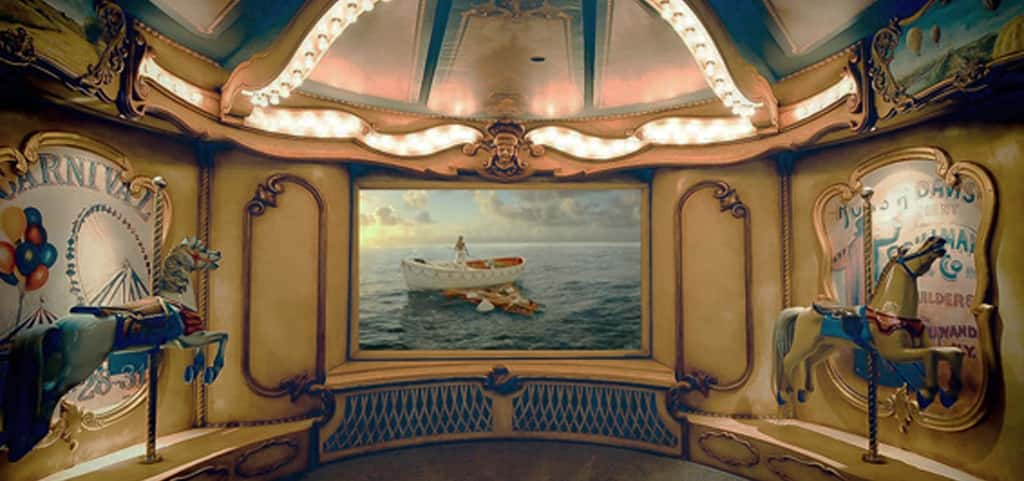 Stepping into this whimsical home theater, you are immediately transported to a 19th-century carnival where you can imagine the early days of cinema. <br /> <br /> Handcrafted by Innovative Theatres in West Hollywood, Calif., for an avid collector of antique carousel horses, this theater re-creates an ornate circus carousel replete with intricate, hand-painted moldings and details that surround custom giclées on the acoustical panels.<br /> <br /> PHOTO CREDIT:<br /> Innovative Theatres Inc.