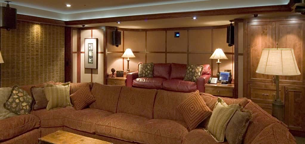 Boulder, Colo.-based Custom Quality Theaters transformed this homeowner's basement into a casual home cinema perfect for family entertaining. The theater offers two levels of seating.<br /> <br /> The multipurpose room includes a retractable movie screen and motorized bamboo shades for better lighting control, while a custom-made wood cabinet at the back hides the A/V source components, as well as refrigerated drawers for drinks.<br /> <br /> PHOTO CREDIT:<br /> Custom Quality Theaters