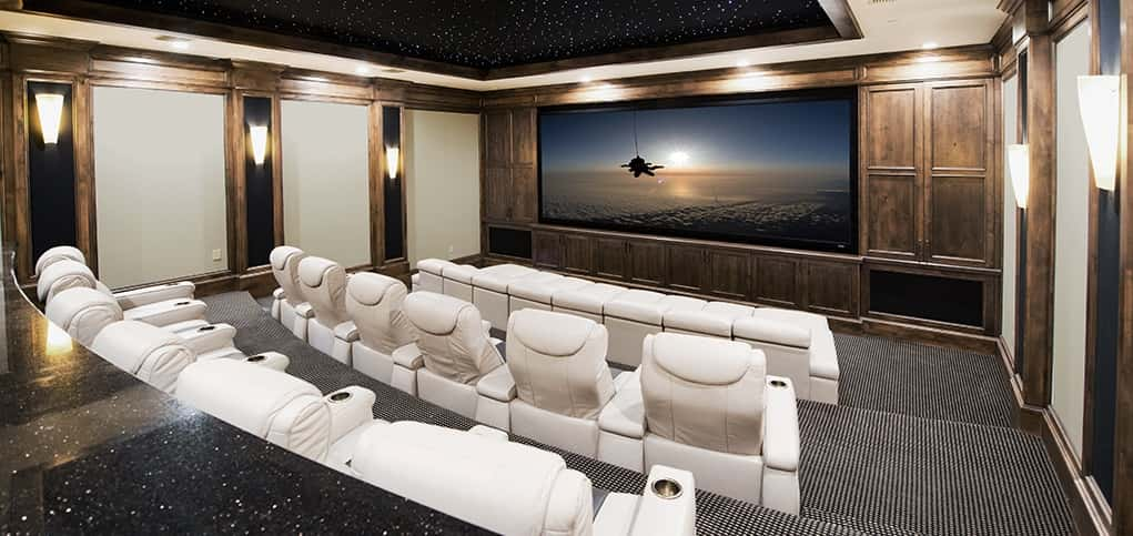 Built for a homeowner in the Texas Hill Country north of San Antonio, this theater blends the best of modern chic with traditional touches such as wood panels for a sophisticated and timeless look.<br /> <br /> Designed by the Dallas-based CinemaTech, this theater features a 16-inch-wide sofa bed, as well as 12 of CinemaTech's Le Grande incliners, all in sleek white leather, for plenty of comfortable viewing options. A fiber-optic ceiling recreates the feel of being under the Texas night sky.<br /> <br /> PHOTO CREDIT:<br /> CinemaTech