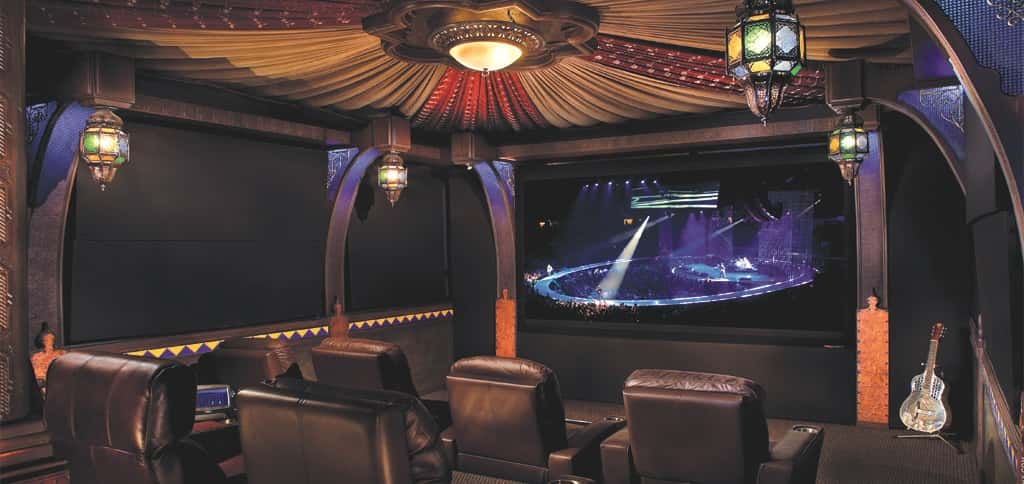 This exotic home theater design from Innovative Theatres was developed from early design and sightline studies for a legendary NBA personality.<br /> <br /> Blending Old World style with New World amenities, this theater includes exquisite decorative details that could have been found in a Marrakech souk, from the colorful lamps and wall details to the rich ceiling fabrics, draped to create the feeling that you in an elaborate Moroccan desert tent.<br /> <br /> PHOTO CREDIT:<br /> Innovative Theatres Inc.