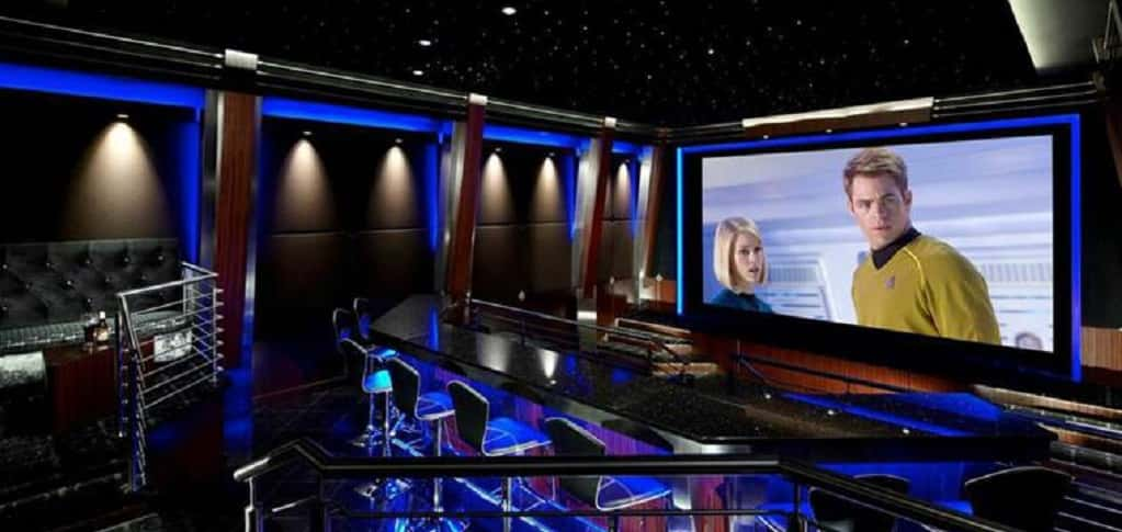 Designed and built over a year and a half by Merrick, N.Y.-based AcousticSmart for a Texas client, this nightclub-inspired theater also doubles as an entertainment space.<br /> <br /> The theater includes a 200-inch screen behind a motorized curtain, a VIP area at the back, a stage, a large bar and comfortable seating for up to 28 people. Granite floors and countertops reflect the ambient lighting created by hidden RGB LED lights and decorative sconces, while rosewood trim and furniture and acoustical wall treatments complete this sleek theater design.<br /> <br /> PHOTO CREDIT:<br /> AcousticSmart