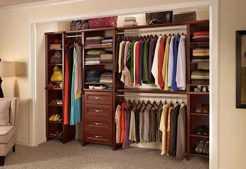 The Impressions Closet Kit is a dark cherry wood shelving with three detachable hanging rods to help keep your clothes from wrinkling and allow them to breathe.