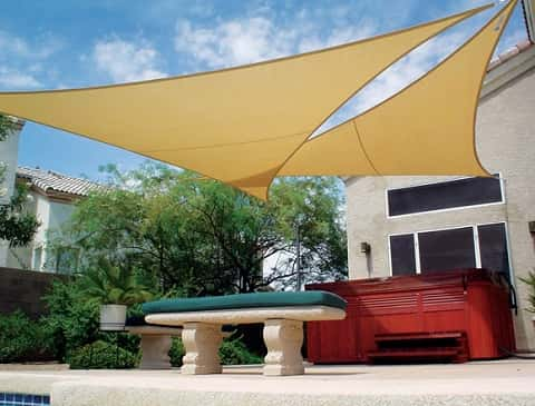 Your outdoor kitchen may be built-in, but your shelter doesn't have to be.<br /> <br /> If adding a major architectural feature like a pavilion to your backyard is more than you want to commit to, consider a shade sail.<br /> <br /> With a great range of colors, UV protection and easy installation, you'll be cooking in the cool in no time.
