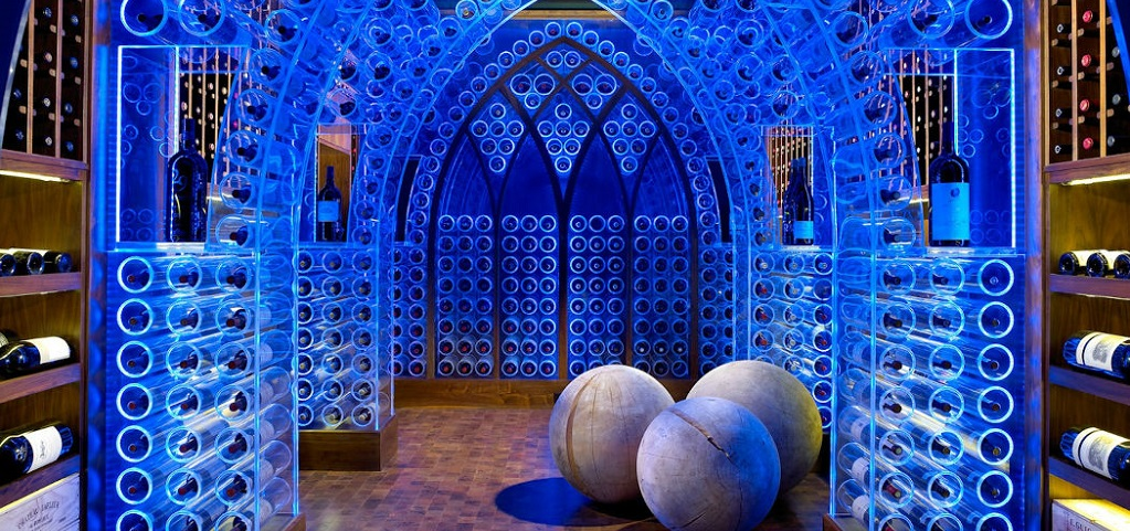 "<p>Who knew blue LED-lit acrylic wine storage could be this cool? This blue gothic wine wonderland created by Jamie Beckwith of <a href=""http://www.beckwithinteriors.com/"" target=""_blank"">Beckwith Interiors</a> for a Nashville, Tenn., pool house features clear acrylic arches that act not only as wine storage, but also as a spectacular lighting feature.<br /> <br /> The temperature-controlled, 2,000-bottle wine cellar is set beneath the pool house's living area. A glass floor allows the cellar to be viewed from above and when the wine cellar is not lit up, a retractable black shade covers the ceiling to keep out unnecessary light.</p> <p > PHOTO BY<br /> Kim Sargent</p>"