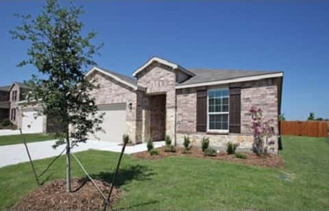 The Atwater plan by Centex Homes has an exterior with brick and decorative brown storm shutters.