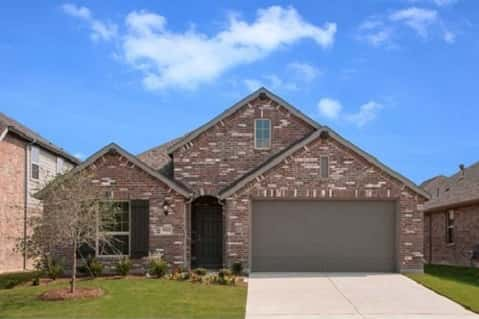 Plan Glenhurst by Highland Homes has an attractive brick exterior.