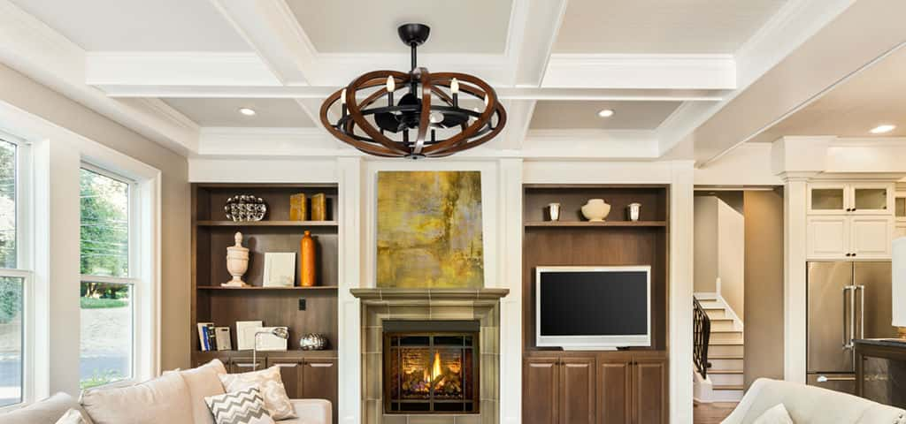 In common areas, statement pieces like a Maxim Lighting fandelier are a fun way to add style and functionality to the spaces. A combination of a fan and a chandelier, it's a unique solution in lighting design, as well as providing airflow.<br /> <br /> The Bodega Bay Fandelier seen here includes rings of distressed ash wood finished in antique pecan for an old-world feel. Metal accents are finished in anthracite, providing a forced iron appearance that complements its rustic look.